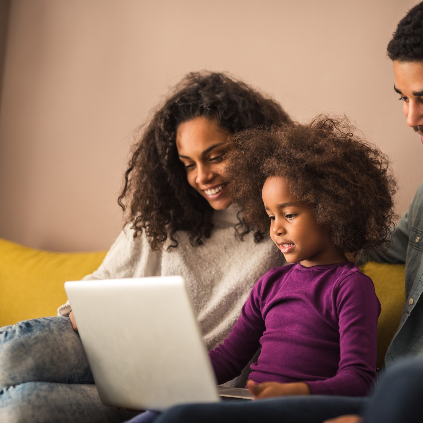 Mother on laptop with daughter
